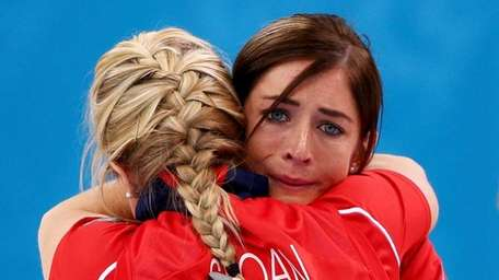 Eve Muirhead of Great Britain, right, shows her
