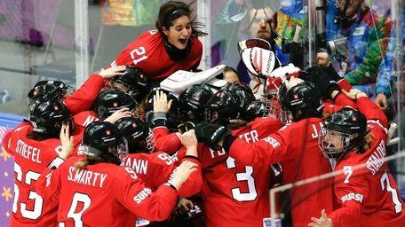 Team Switzerland celebrates their 4-3 win over Sweden