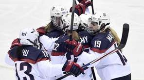 United States players celebrate Meghan Duggan's goal against