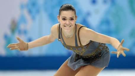 Adelina Sotnikova of Russia competes in the women's