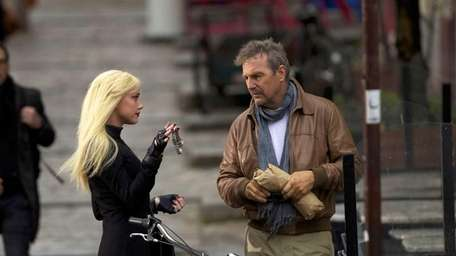 Amber Heard and Kevin Costner in a scene