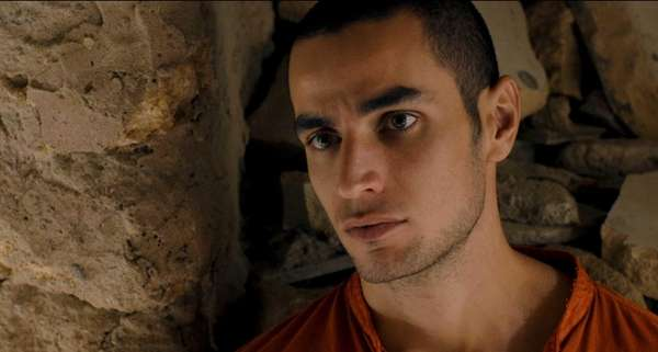 Omar (Adam Bakri) is a young Palestinian man