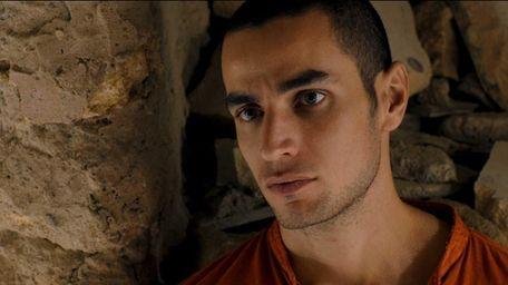 Omar (Adam Bakri) is a young Palestinian man