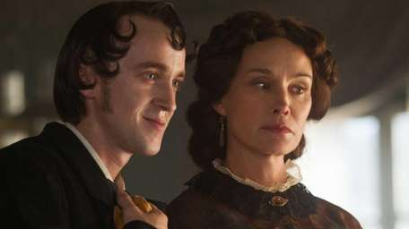 Tom Felton as Camille Raquin and Jessica Lange