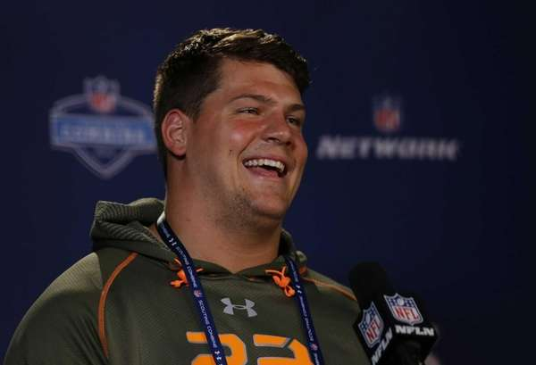 Michigan offensive lineman Taylor Lewan answers a question