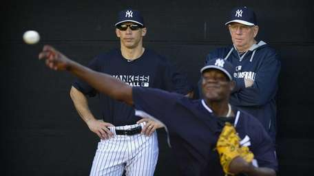 Yankees manager Joe Girardi and pitching coach Larry