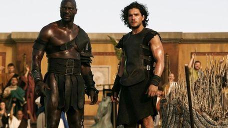 Atticus (Adewele Akinnouye-Agbaje), left, and Milo (Kit Harington)