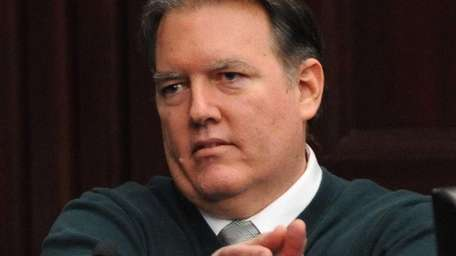 Michael Dunn, gestures on the stand in his
