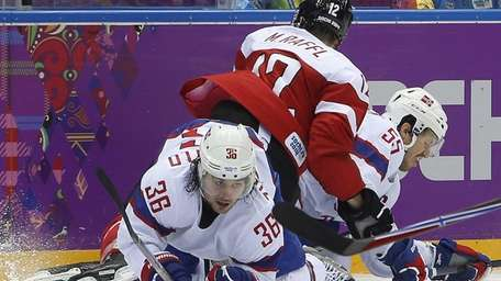 Norway forward Mats Zuccarello gets tangled up with