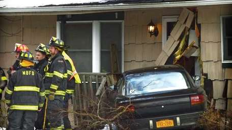 A car careened onto the front stoop of