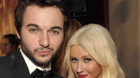 Matt Rutler and Christina Aguilera attend the InStyle
