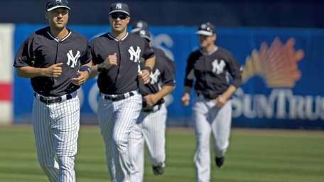 Derek Jeter and Mark Teixeira work out with