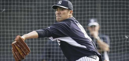Yankees starting pitcher Masahiro Tanaka throws a pitch