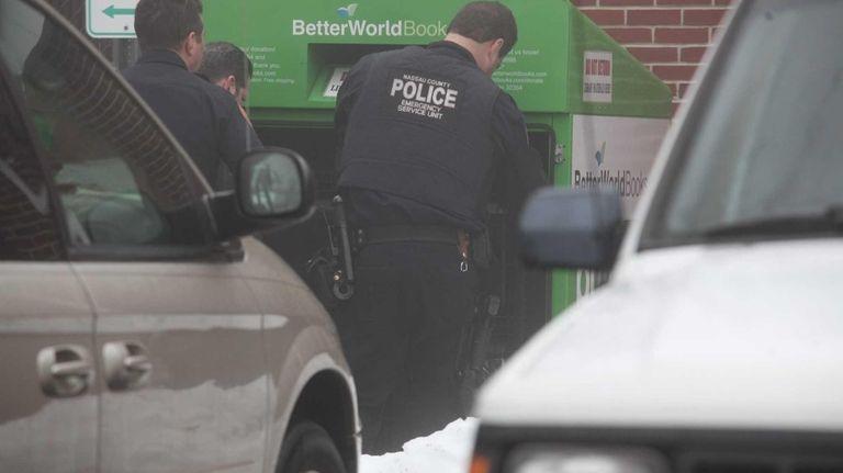 Nassau police investigate the scene at the Bellmore