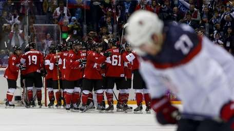 Team Canada celebrates after beating the USA 1-0