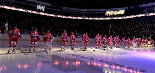 Lokomotiv Yaroslavl players listen to the national anthem