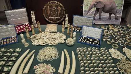 Jewelry and carvings are displayed during a press
