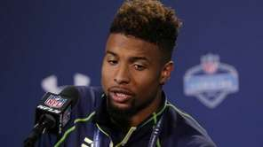 Louisiana State wide receiver Odell Beckham answers a