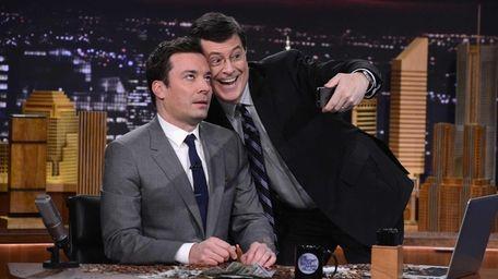 Stephen Colbert snaps a selfie during Jimmy Fallon's