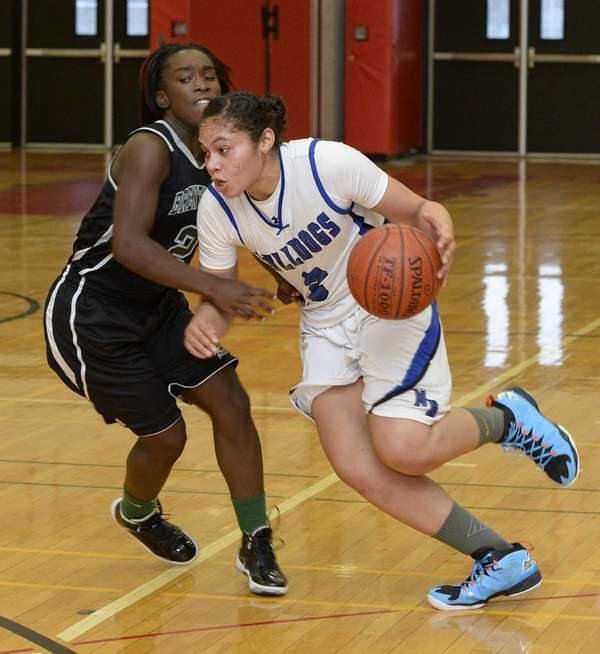 North Babylon guard Brianna Jones drives against Brentwood