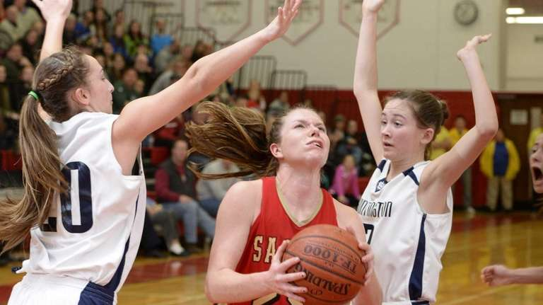 Sachem East guard Katie Doherty drives to the