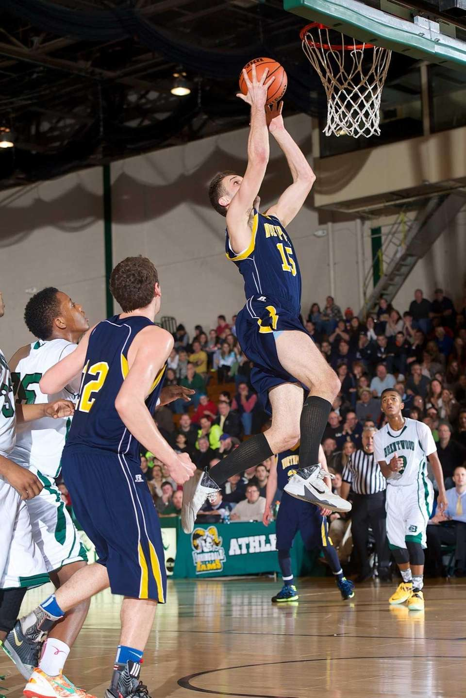 Northport forward Kenny Radigan attempts a layup during