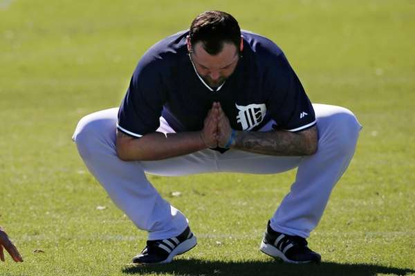 Detroit Tigers pitcher Joba Chamberlain stretches during the