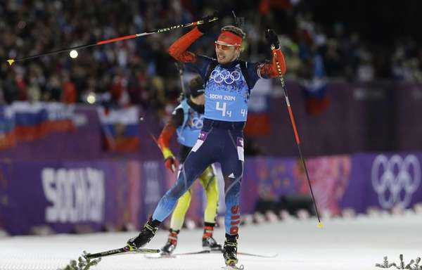 Russia's Anton Shipulin celebrates on the finish straight