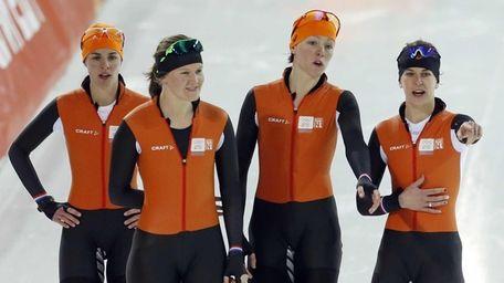 Dutch speedskating teammates Marrit Leenstra, from left, Lotte