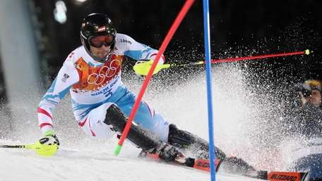Austria's Mario Matt skis past a gate in