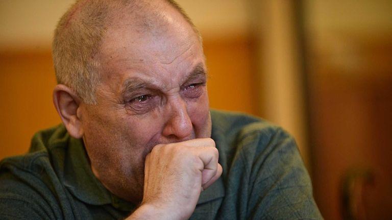 Zinoviy Zakalyuk watches footage of himself at the