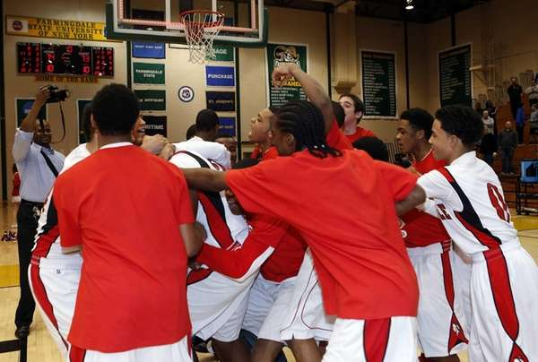 Amityville's boys basketball team celebrates its 74-73 overtime