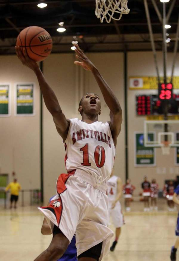 Amityville's Travis Dickerson drives for the layup in