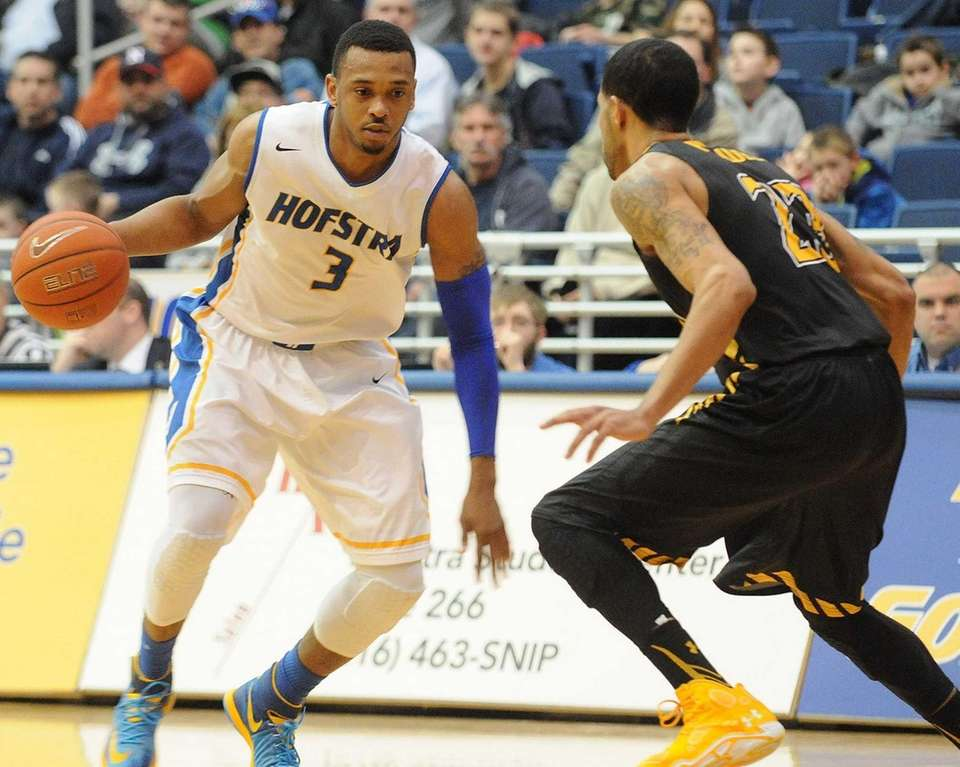 Hofstra's Zeke Upshaw, left, looks to dribble past