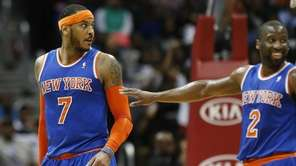 Carmelo Anthony is pushed away by teammate Raymond
