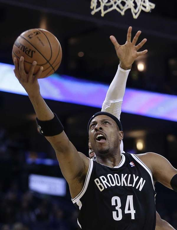 Nets' Paul Pierce lays up a shot against