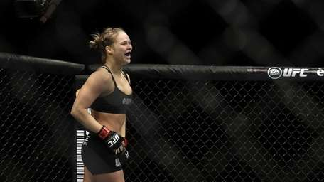 Ronda Rousey reacts after defeating Sara McMann following