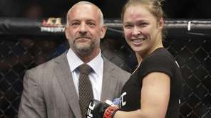 Ronda Rousey, right, smiles with UFC owner Lorenzo