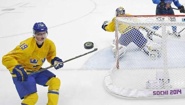 Sweden forward Nicklas Backstrom watches a shot that