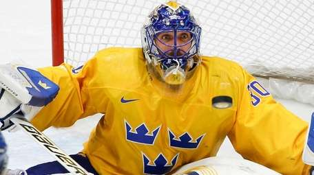Goalkeeper Henrik Lundqvist of Sweden (30) looks at