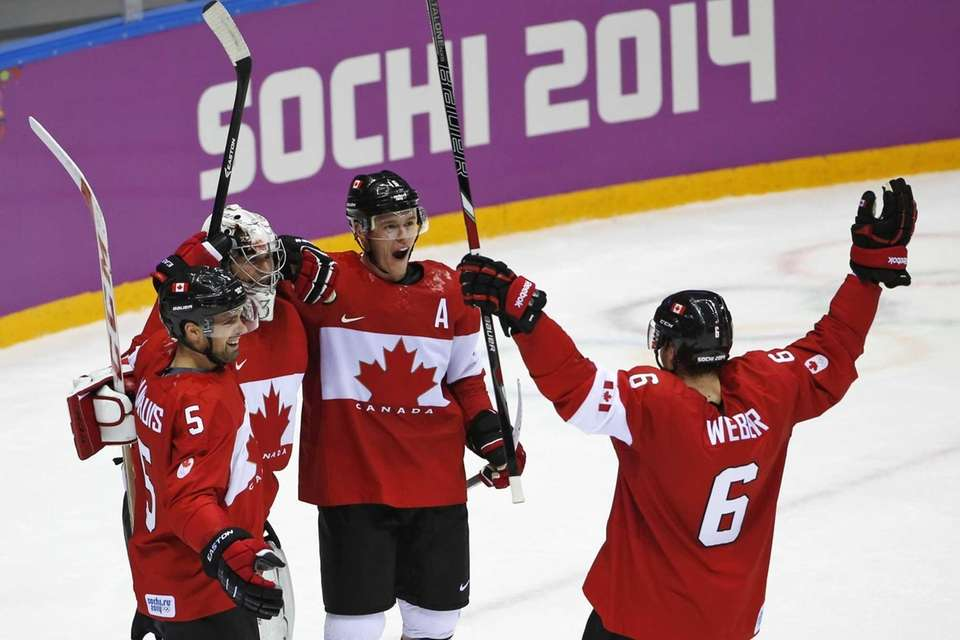 Dan Hamhuis of Canada (5), goalkeeper Carey Price