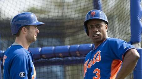 David Wright and Curtis Granderson talk during spring