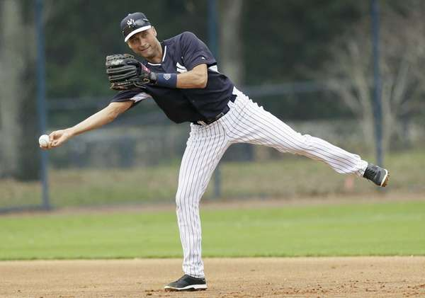 Derek Jeter throws to second base during spring