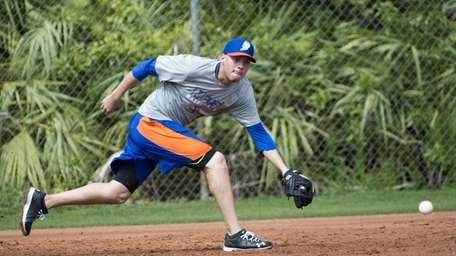 Wilmer Flores catches a ground ball during spring