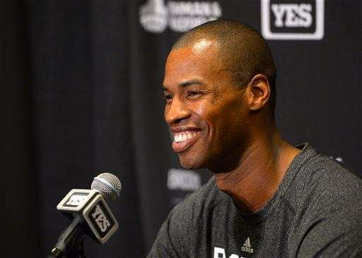 Nets center Jason Collins speaks during a news