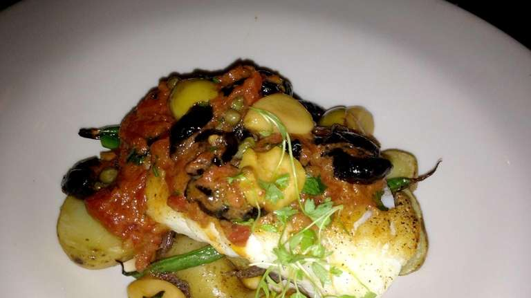 Cod puttanesca is served at Verde restaurant in