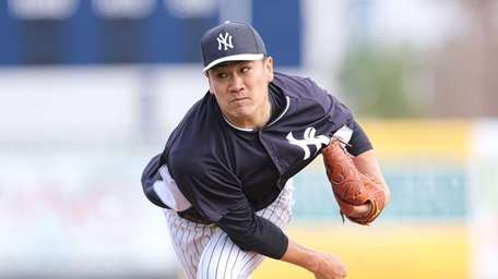 Masahiro Tanaka pitches batting practice during a morning