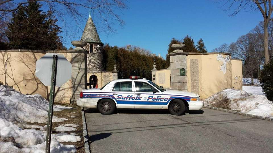 Suffolk County Police block the gate to Oheka