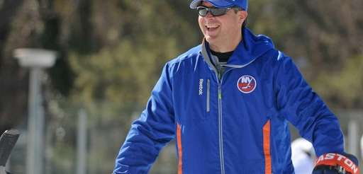 Islanders head coach Jack Capuano laughs during an