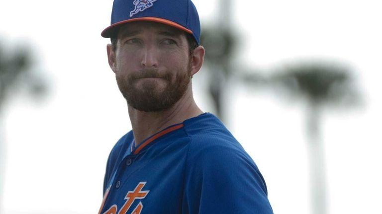 Mets first baseman Ike Davis looks on during